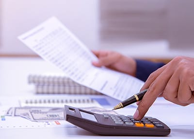 business person crunching numbers