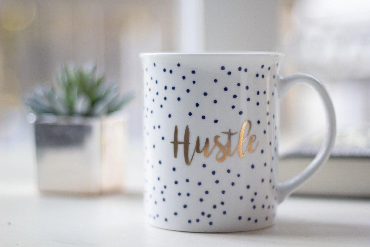 mug with hustle text on it